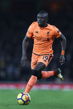 Liverpool's Senegalese midfielder Sadio Mane controls the ball during the English Premier League football match between Arsenal and Liverpool at the Emirates Stadium in London on December 22, 2017.  / AFP PHOTO / Adrian DENNIS / RESTRICTED TO EDITORIAL USE. No use with unauthorized audio, video, data, fixture lists, club/league logos or 'live' services. Online in-match use limited to 75 images, no video emulation. No use in betting, games or single club/league/player publications.  /