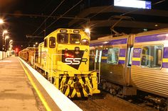 T381 with a sleeper train waits for a down Comeng to shunt to the sidings at Broadmeadows