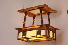 Prairie Style ceiling light, cherry, leather, leaded glass.