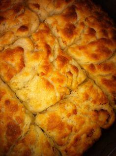 Butter Swim Biscuits - 2 1/2 C all-purpose flour; 4 t baking powder; 4 t sugar; 2 t salt; 1 3/4 C buttermilk; 1 stick unsalted butter. - Mix dry. Add bttrmilk (1,75C milk, 1.75T white vinegar, wait 5 min.). Mix to ball. Add melted butter to 9x9 pan. Add dough; cut it. Butter comes to top. Bake 450 F 25 min.