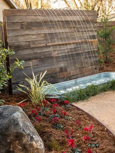 Wood and Water In a Sacramento backyard redo, the Yard Crashers crew created this impressive water feature using reclaimed wood.