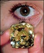 Mouna Diamond      Mouna diamond  Weigh: 112.50  Shape: cushion  Color: fancy intense yellow