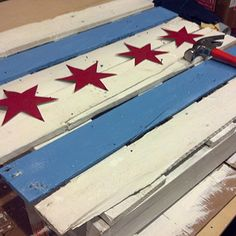 Hanging #chicago flag pallet. Now available as a #coffee table as well!  #art #homedecor #reclaimed #repurposed Available in-store only!