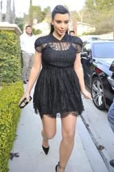 Kim Kardashian stepped out in a simple black lace skater dress