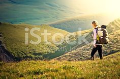 Woman Traveler with Backpack hiking in Mountains royalty-free stock photo