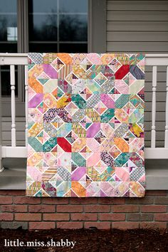"Great scrappy modern quilt and I love the technique that littlemissshabby uses for the hugs n kisses block.  Great way to use up those 5"", 3"" and 2 1/2"" cut up scraps!!!"