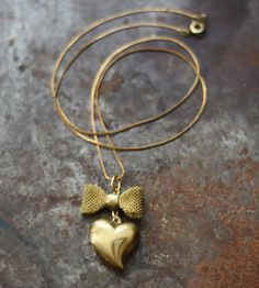 Vintage Brass Heart and Bow Necklace by contrary on Etsy