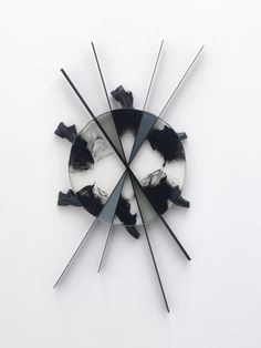 Lisa Lapinski - Disk 3, 2011  epoxy paint, steel, shoes, hardware   133 x 75 x 6,4 cm