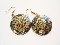 recycled brass earrings with Indian flowers on blue background