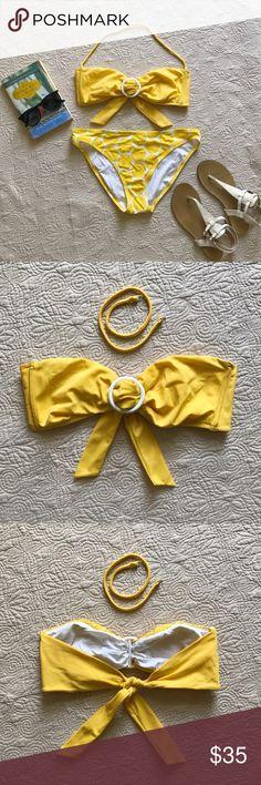 Victoria's Secret Bikini Set **Bikini Top: L** ☀️ **Bikini Bottoms: M** Excellent condition! Bandeau style top ties in back and has removable strap. Bikini bottoms coordinate in white with yellow polka dots. Victoria's Secret Swim Bikinis