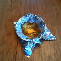 Put foil in a bowl, poor in grease. When it hardens, roll up, throw away. Duh, why didn't I think of that?