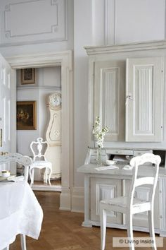 The tones in the wood warm the space, but I wouldn't be against painting that white too!