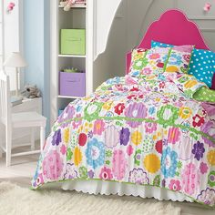 Girls Bedrooms ~ Pop Garden Bedding: Flower power to the max! Brightly colored flowers cover this pretty girls' quilt from head to toe. In bright tones of pink, yellow, blue, green and other colors on a clean white background.