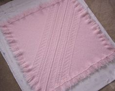4 ft Tri-loom blanket. Two triangles attached with Swedish Weave embellishment. Sandra's Stitches