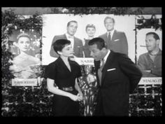 Audrey Hepburn and William Holden   Wiiliam presenting Audrey with her Oscar.