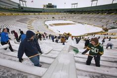 Packer Fans are DIE HARD. We volunteer to shovel snow on game day at Lambeau  Field.