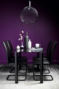 Ultra violet wall in dining room. Visit houseandleisure.co.za for more.
