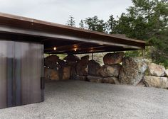 the Pierre house by Olson Kundig Architects, dynamite was used to carve out the site for this raw concrete house that nestles among the boulders on one of the San Juan Islands, off the coast of Seattle, USA
