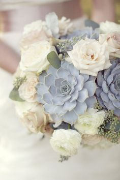 succulents, roses, and seeded eucalyptus bridal bouquet