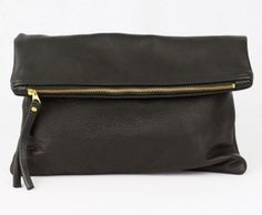 Only the most amazing leather clutch ever made <3 www.mooreaseal.com