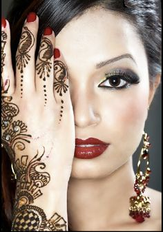 I think i may have been Indian in another life...I love this pic...makeup, red nails and lips, tattoo...