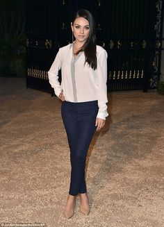 Looking good: Mila Kunis is already back in her blue cigarette pants as she attended the B...