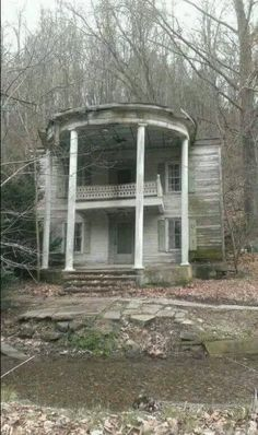 Abandoned homes... looks like a little house to have such a big front porch with pillars