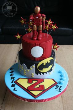 Super Hero Cake I like the idea of putting the childs initial in the logo though...so like put an F instead of an S on the superman (if you want superman) wasn't sure if we were doing marvel or dc :) @Jennifer Morgan-Eder