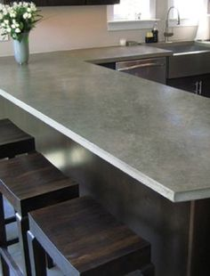 Concrete Counter Top How gorgeous is this counter top? It's a custom taupe colored concrete kitchen counter (alliteration unintended) by Trueform Concrete, a residential and commercial concrete. Cost Of Concrete Countertops, Concrete Kitchen Counters, Diy Concrete, Countertop Options, Polished Concrete, Slate Countertop, Countertop Materials, Laminate Countertops, Slate Worktops