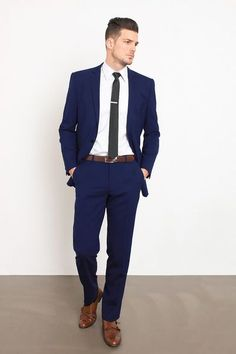 Sometimes, a simple navy suit just works. It fits perfectly and never disappoints. Stylish Engagement Party Attire for the Groom Mode Masculine, Blue Suit Men, Navy Suit Brown Shoes, Blue Suits, Prom Suit Blue, Blue Prom Suits For Guys, Navy Fitted Suit, Formal Navy Blue Suit, Blue Suit Black Tie