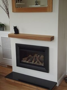 A great example of one of our air dried oak beams placed above a log burning stove. take a look at our website to see our full range of oak mantel shelves (www.oakfiresurrounds.co.uk)