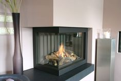 Are you looking for some amazing ideas for your new corner fireplace? Explore the top best corner fireplace designs featuring luxury angled interior ideas and inspiration. White Corner Electric Fireplace, Corner Fireplace Tv Stand, Corner Fireplace Mantels, Basement Fireplace, Fireplace Pictures, Living Room With Fireplace, Fireplace Design, Fireplace Ideas, Fireplace Brick