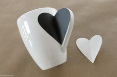 IY Craft Project: Sharpie Mug Tutorial - 1. Wash the cup with ALCOHOL and let it dry 2 Make a HEART TEMPLATE... 3. Using an OIL based SHARPIE draw and write a design. Let it dry 10 min before removing template-let it dry 30 min 4. BAKE 350 for 20 min.Turn Oven off-let it cool completely. REPEAT the baking ! 5. SEAL with KRYLON CRYSTAL CLEAR ( but protect the upper edge with a painter's Tape)