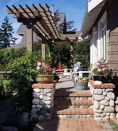 The color of this pergola matches the siding on this Arts and Crafts bungalow. The stepped horizontal braces and interconnected timbers are a trademark Craftsman touch, which help marry the new pergola with the older Craftsman house./