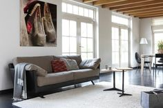 Valdivia sofa with leather body and fabric cushions