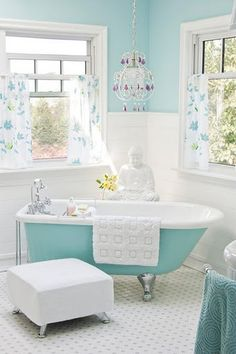 Blue is the color of water and is perfect for bathroom decor. Turquoise is soothing. Love this zen like  bathroom atmosphere. The open windows lets in lots of light and air to create zen harmony.