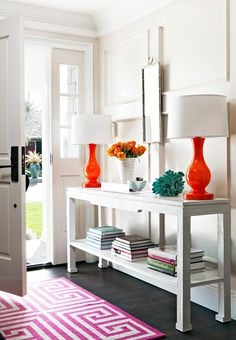 Outfit an entryway table with colorful accessories for a fun pop of personality right inside the door. This intricately carved table topped with glossy orange lamps and turquoise knickknacks makes a splash against white walls. #entryway #entrywaydecor #smallentryway #entrywaywall #bhg Style At Home, Entryway Decor, Entryway Tables, Entryway Ideas, Entrance Foyer, Foyer Bench, Entrance Table, Entryway Console, Modern Entryway