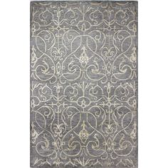 Add a pop of pattern to your living room or den with this hand-tufted wool and art silk rug, showcasing a scrolling motif for stylish appeal.