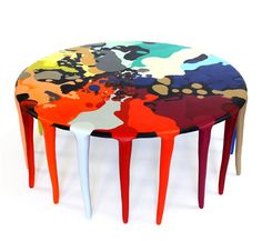 'Full Moon' by Louise Olsen and Stephen Ormandy of Dinosaur Designs.  Resin table with 21 legs, 480mm high x 1200mm diameter.