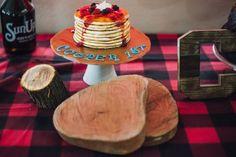 Lumberjack Birthday Party, Plaid Cake, Banana Pancake cake, log cabin, wood colored pencils, Trail mix bar, chili bar, wood slices table setting, red lanterns, do not feed the bears, toentertian, to entertain