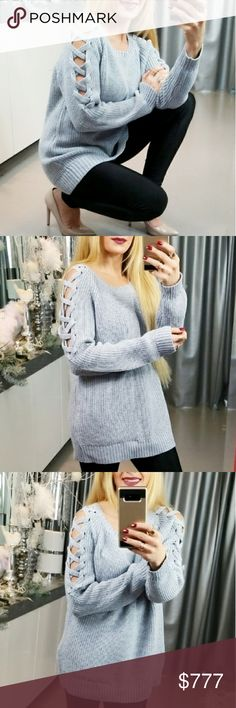 HEATHER GRAY LACE UP DETAILED SWEATER Brand new Boutique item Price is firm Bundle to save  Fabulous heather gray knitted oversized sweater featuring popular lace-up details on the sleeves. Absolutely perfect color & style for the season. Make this sweater a staple for your fall/ winter wardrobe! Pair with our butterfly jeans and pink jacket or a pair of our fleeced lined leggings.    Material 65% acrylic 20% polyester 15% nylon Modeled in a size small . Sweaters Crew & Scoop Necks