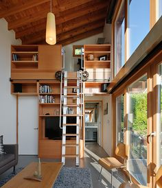 Stairs on wheels  / living space tucked away up there with a view . Window walls