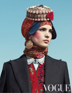 Hanaa Ben Abdesslem is the face of fashion shoot with clothing items from all over the world in Dutch Vogue 2013.