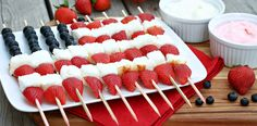 PATRIOTIC BERRY KABOBS...1pint fresh strawberries-halved/quartered,1c fresh blueberries,1 angel food/pound cake-cut 1# cubes,Wooden skewers,Serve w/Marzetti Fruit Dip:Cream Cheese/Strawberry Cheese/Chocolate...American flag:thread 6+ blueberries on 4-5 skewers, followed w/alternating cake+strawberry.Start w/cake (below blueberries) end w/strawberry.On 5-7more skewers,alternate cake+strawberries, making sure fruit+cake align to create stripes.# of skewers depends on flag sz. Arrange on…