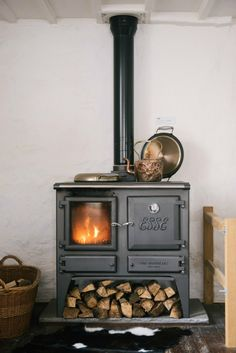 Beautiful utility never goes out of style. And lasts forever- this ESSE woodburning stove with cooktop is perfection and so inviting.