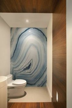 agate wall..talk about adding an Earth element to a room that is typically heavy on the Water element!