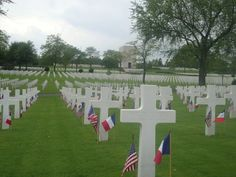 Lorraine American Cemetery, St. Avold, France... When I was in Jr High we used to go here over Memorial day and help put all these flags by each stone.