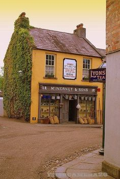 Old fashioned corner shop in England and Lyon's tea shop!-----*sigh* there are millions of corners in England. Wish this listed which town or village. Café Restaurant, Tee Shop, England, Fashion Corner, Shop Fronts, Shop Around, English Countryside, Mellow Yellow, Mustard Yellow
