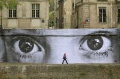 I would bet this is one of JR's, French Artist.....Insideoutproject.net    http://www.ted.com/talks/jr_s_ted_prize_wish_use_art_to_turn_the_world_inside_out.html