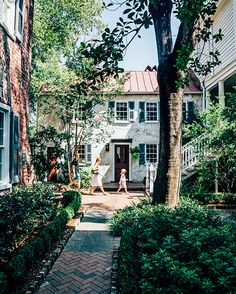 From Garden & Gun Magazine - Exterior Shutters on a traditional, historic home in Charleston SC. Photo Credit: Peter Frank Edwards. Zero George's cozy courtyard.